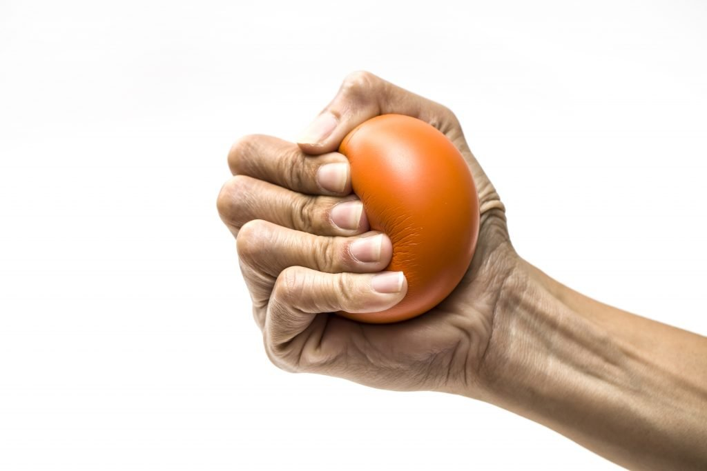 Woman squeezes stress ball