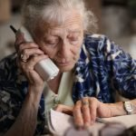 Senior woman talks on the phone